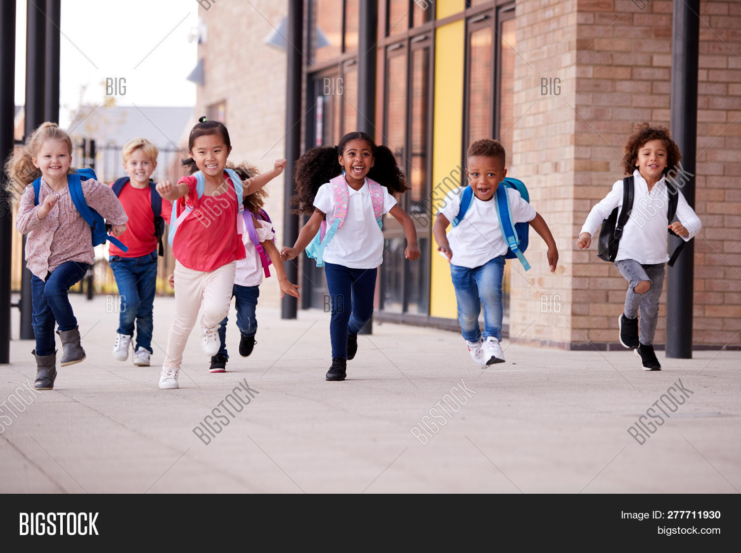 backpack,bonding,break time,building exterior,childhood,children,classmates,confident,copy space,day,energy,excited,friends,front view,full length,girls,happy,home time,horizontal,indoors,infant school,kids,kindergarten,late,looking ahead,low angle,medium group of people,modern architecture,multi-ethnic group,nursery school,pre-teens,pupils,recess,registration,rucksack,running,school kids,schoolbag,schoolboys,schoolchildren,schoolgirls,smiling,togetherness,urgency,walkway,youth