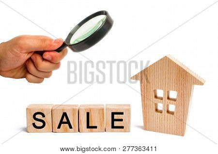 wooden house with the inscription sale on white isolated background. sale of property, home. affordable housing. sale of apartments. real estate agent services. realtor stock photo