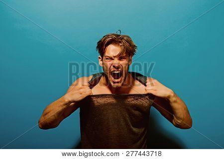 Anger Concept. Aggressive Man Shout With Anger. Guy Tear Tshirt With Anger. Anger Attack. I Am So An