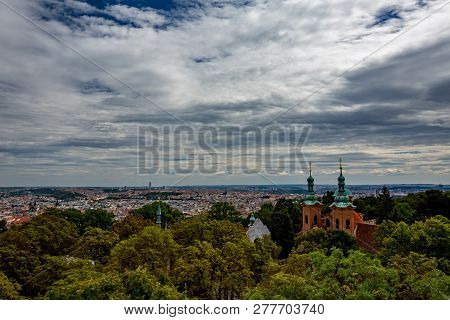 Amazing architecture of Cathedral of Saint Lawrence in Petrin Park, Prague, Czech Republic as seen from above, observation and lookout tower stock photo