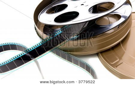 A container of film strip film reel and film can on a white background stock photo