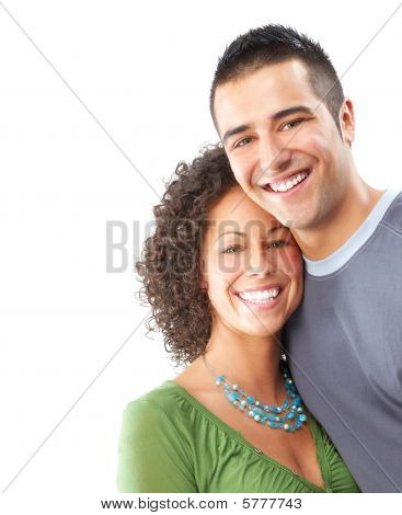 Happy smiling couple in love. Over white background stock photo