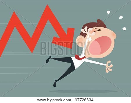 Depressed Businessman Leaning His Head Below a Bad Stock Market Chart stock photo