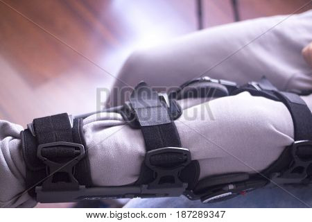 Physical therapy mecical clinic physiotherapy orthopedic adjustable leg brace for knee injury and rehabilitation. stock photo