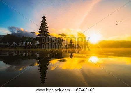 Pura Ulun Danu Bratan Hindu temple on Bratan lake landscape one of famous tourist attraction in Bali Indonesia. Pura Ulun Danu Bratan at sunrise Bedugul Bali Indonesia. Bali Indonesia sunrise. Bali Indonesia temple. Bali Indonesia landmark. Bali Indonesia