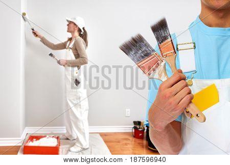 Painter hand with painting brush stock photo