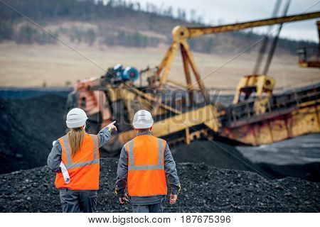 Coal mine workers in an open pit stock photo