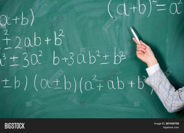 Teacher On School Lesson At Blackboard. Back To School. Teachers Day. Study And Education. Modern Sc