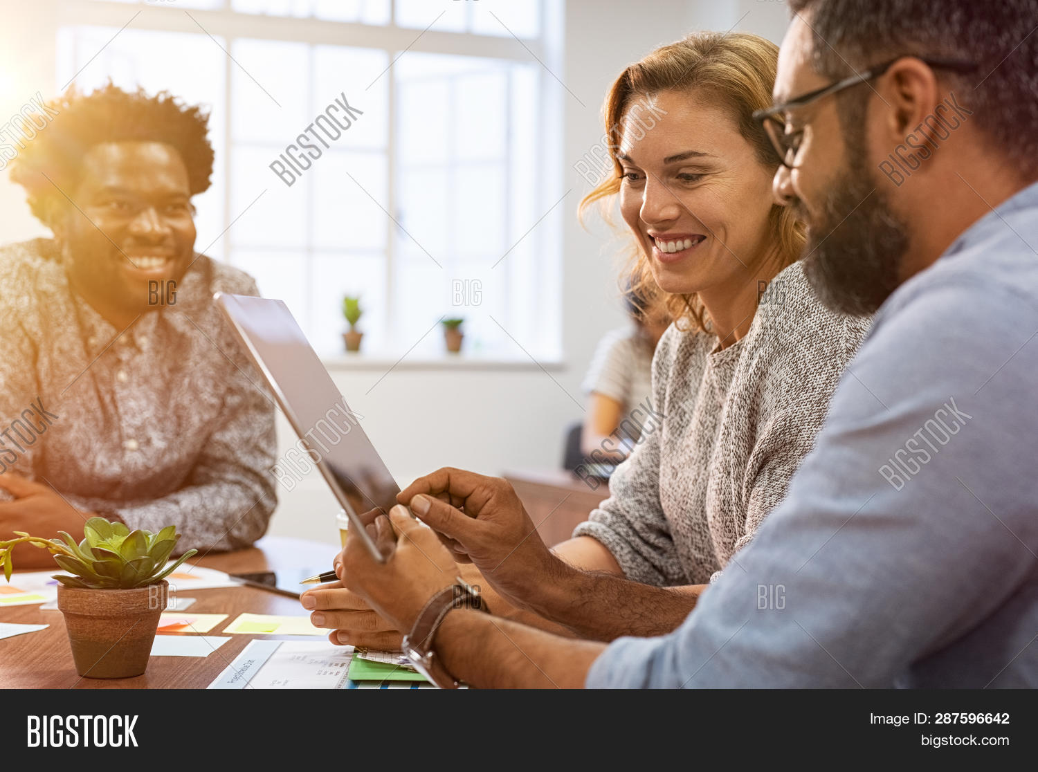 african american,boss and employee,business casual,businessman,businesswoman,casual business,casual business meeting,casual meeting,cheerful,co working,colleague,communication,computer,cooperate,corporate,creative,digital,digital tablet,discussion,discussion group,group,happy,indian man,lifestyle,man,mature,meeting,middle eastern,modern office,multi ethnic business,multi ethnic group,multiethnic,office,partnership,people,showing,sitting at table,smile,success,successful,tablet,team,teamwork,technology,together,toothy smile,using,using tablet,woman,work