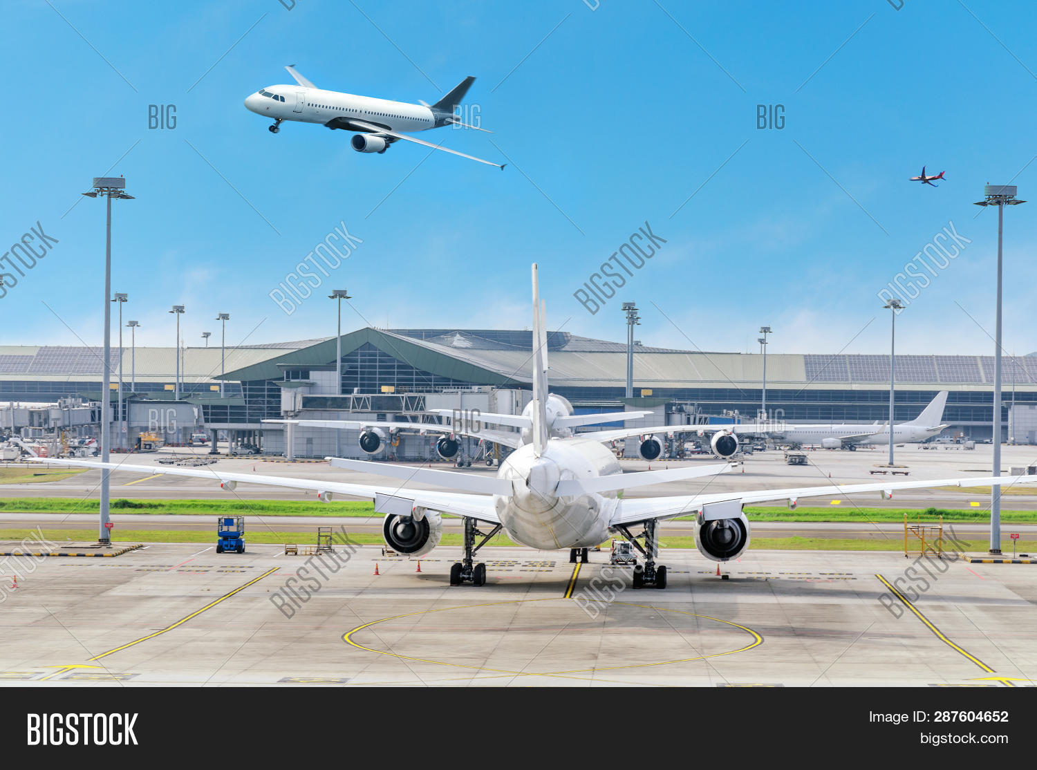 aerospace,air,airbus,aircraft,airfield,airplane,airport,arrival,arrive,aviation,blue,building,business,cargo,civil,clear,commercial,day,descending,down,dynamic,flight,fly,gate,gear,horizon,international,jet,land,malaysian,no,parking,people,plane,runway,sky,speed,sun,take,takeoff,terminal,tourism,transport,transportation,travel,trip,tropic,view,waiting,white