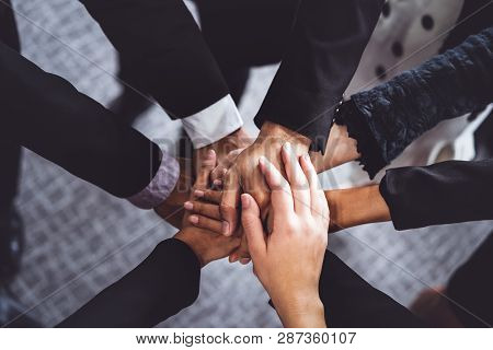 Many Happy Business People Join Hands Together.
