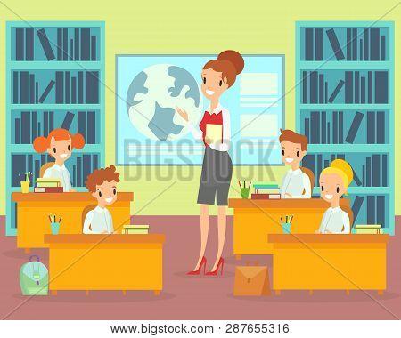 Vector Illustration Children In Classroom With Teacher. Female Teacher Teaches Students In Elementar