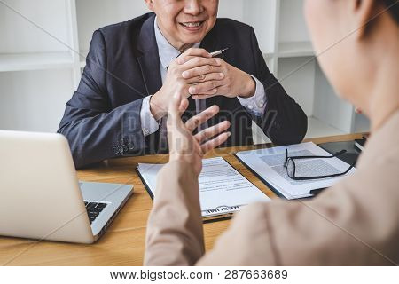 Job interview, Senior selection committee manager asking questions to applicant about work history, colloquy dream,  Skill, expertise, experience and businessman listen to candidate answers. stock photo