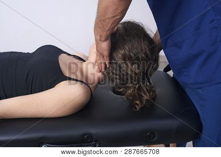 Young woman having chiropractic back adjustment. Physiotherapy, sports injury rehabilitation. Osteopathy, Alternative medicine, pain relief concept stock photo