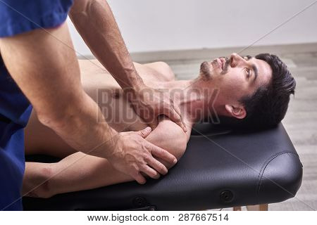 Therapist doing diacutaneous Fibrolysis, of the hooks healing treatment on man's back. Alternative medicine. Chiropractic, osteopathy, manual therapy, acupressure stock photo