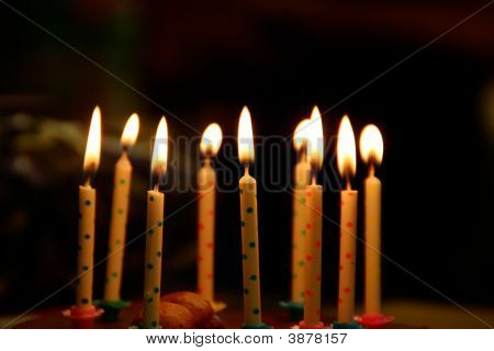 Birthday cake candles burning - 9 in this image stock photo