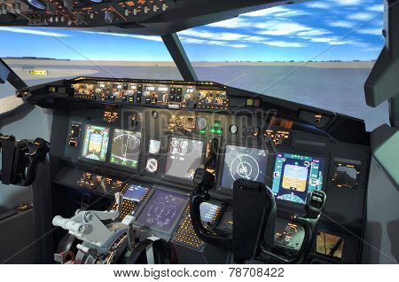 A view from inside flight simulator B737 cockpit. stock photo