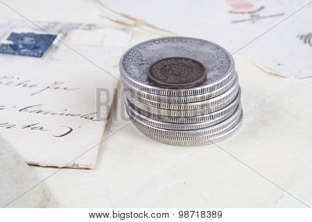 Vintage background with old paper old ink pen handwriten letters and silver coins stock photo