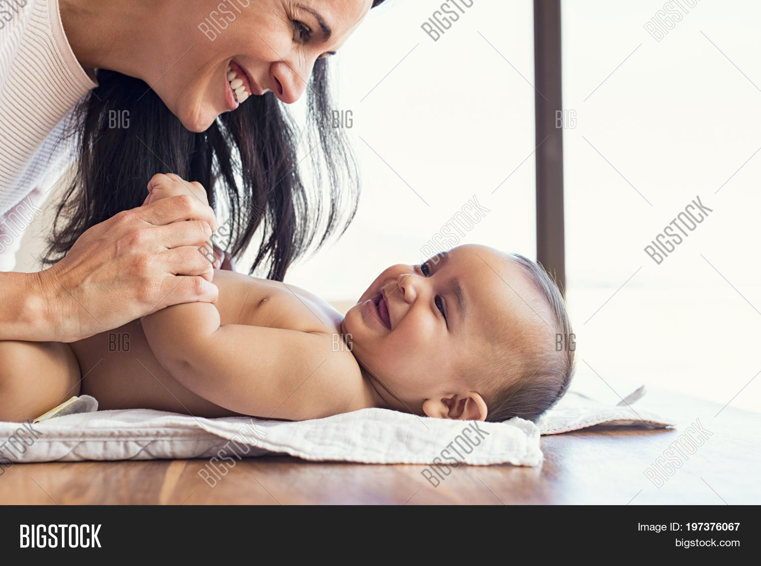 adorable,baby,baby bath,bath,care,change,cheerful,child,closeup,cute,cute boy,diaper,diaper change,diaper changing,family,happy,happy baby,hispanic,infant,infant baby,infant care,kid,latin,love,lovely,maternity,mom,mother,mother and baby,mother and son,nappy,newborn,pamper,parent,people,play,smile,smiling baby,son,table,tickle,toddler,toddler boy,woman,young