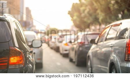 Car and traffic jam concept - Blurred row of car on evening treaffic jam hour in bangkok thailad and copyspace Use for city and car traffic problem content