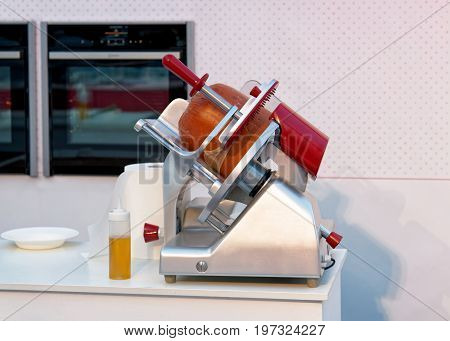 Equipment for cutting Italian traditional Bologna sausage on Bologna market Italy stock photo