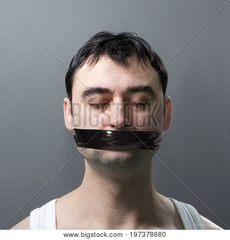 man's portrait with black duck tape on his face stock photo