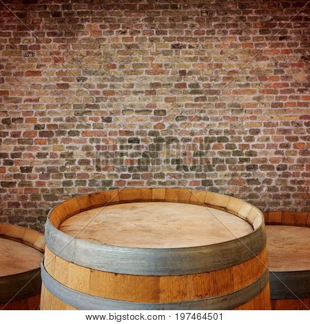 Wooden wine barrel over brick walll background. Oktoberfest concept stock photo