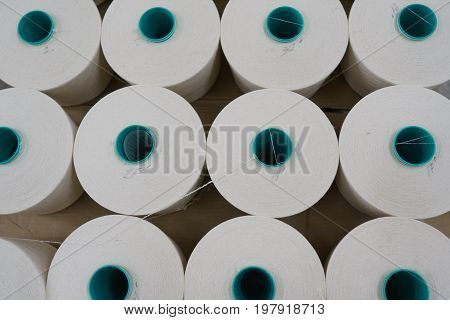 large group of bobbin thread cones on a warping machine in a textile mill. stock photo