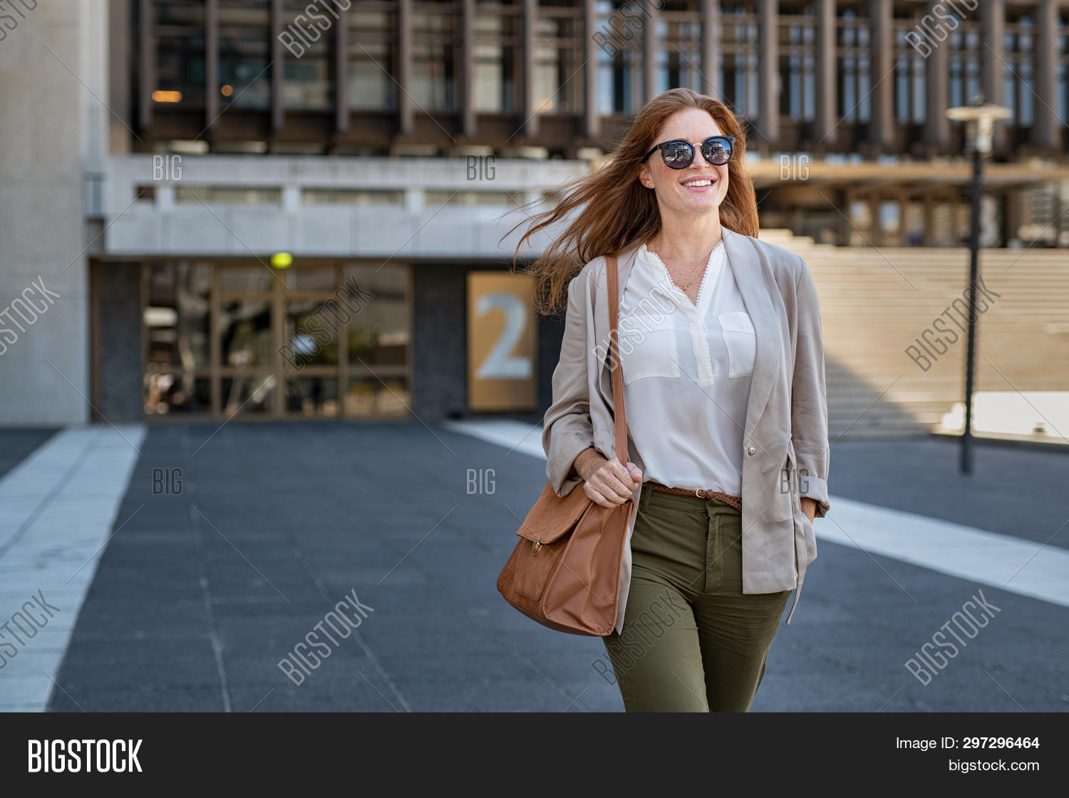 attractive,beautiful,beauty,building,business,business woman,businesswoman,career,carefree,casual,casual woman,cheerful,city,city background,confident,copy space,end work,entrepreneur,fashion,fashionable,free,girl,go to shop,go to work,happy,lifestyle,mature,modern building,office,outdoor,people,positive,proud,red hair,satisfaction,satisfied,serene,smile,street,success,successful,sunglasses,toothy smile,urban,walk,wearing sunglasses,woman walking away,woman walking street,work