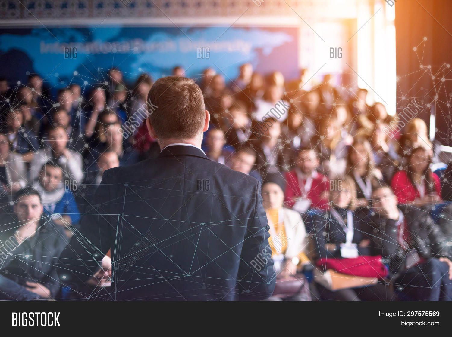 academic,audience,briefing,business,businessman,coaching,conference,congress,convention,corporate,dots,education,educator,entrepreneur,entrepreneurship,explaining,gesturing,giving,group,hall,indoors,information,institute,knowledge,learn,lecture,male,man,manager,meeting,participants,people,presentation,public,rear,screen,seminar,speaker,study,successful,teacher,teaching,teamwork,training,university,view,workshop