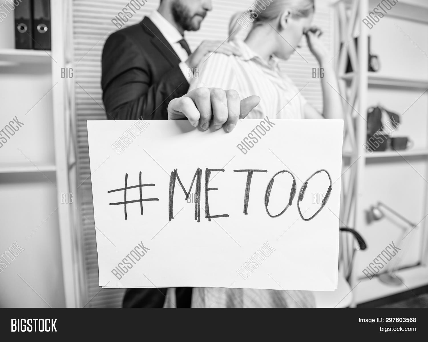 Discrimination assault complaint. Scandal sexual abuse victim. Assault at workplace. Assault targeted at employee. Girl hold poster hashtag me too while colleague calm down her. Share assault story