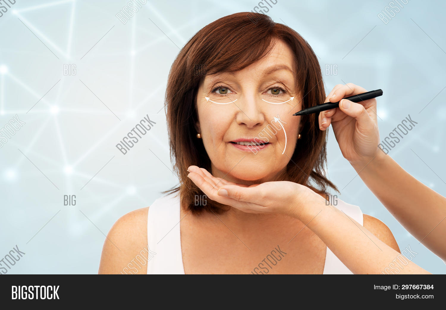 beauty, plastic surgery and anti-age concept - senior woman with with face lifting arrows and surgeon's hands with marker over blue background with low poly mesh