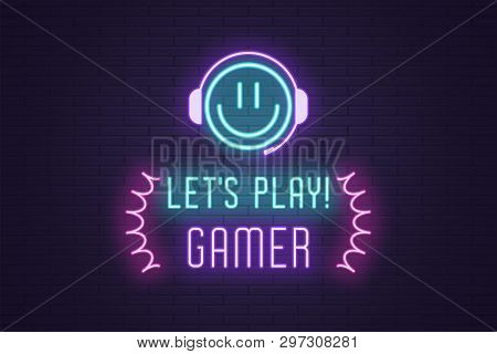 Neon composition of headline Lets Play Gamer. Glowing Neon Emoji with Headphones and text Lets Play Gamer. Bright digital signboard for Gaming industry, Vector. Blue, violet and pink color stock photo