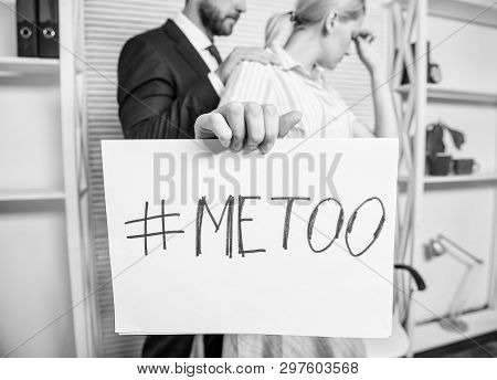 Discrimination assault complaint. Scandal sexual abuse victim. Assault at workplace. Assault targeted at employee. Girl hold poster hashtag me too while colleague calm down her. Share assault story stock photo