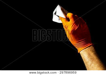 Car polish wax worker hands polishing car. Buffing and polishing vehicle with ceramic. Car detailing. Man holds a polisher in the hand and polishes the car with nano ceramic. Tools for polishing stock photo