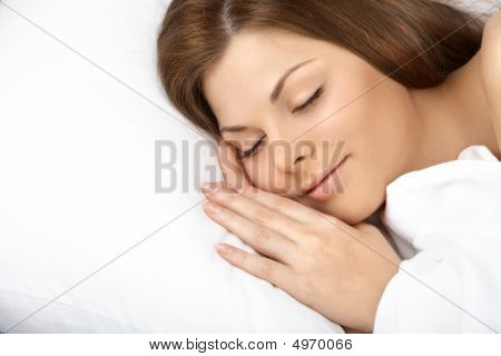 Portrait of the beautiful sleeping woman in white bed stock photo