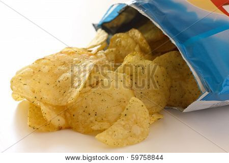 Blue packet of crisps with cheese and spri ng onion flavour stock photo