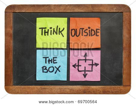 think outside the box concept - colorful sticky notes on a vintage slate blackboard  isolated on whi