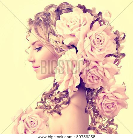 Beauty girl with rose flowers hairstyle isolated on white background. Fashion model  woman portrait