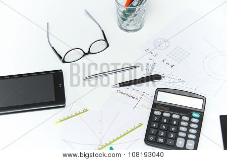 photo of the Architectural plans and projets pencils rulers compass calculator tablet glasses and other tools ** Note: Visible grain at 100%, best at smaller sizes stock photo