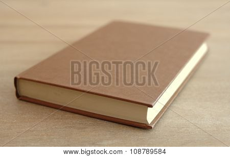 Side view of an old book on a table stock photo