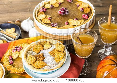 Homemade pumpkin pies with Autumn stamped leafs. stock photo