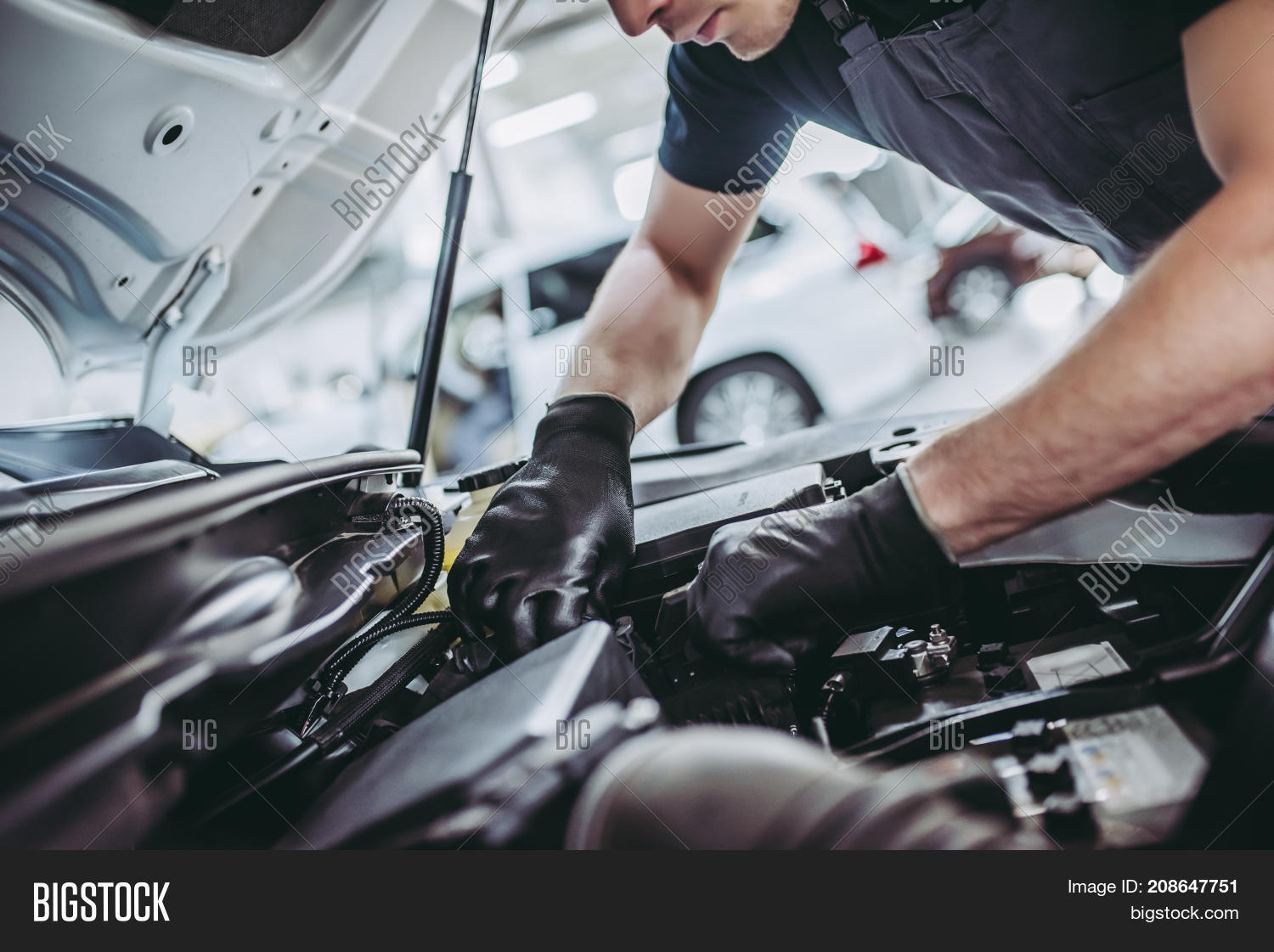 adult,auto,automobile,automotive,background,business,car,caucasian,check,cropped,engine,fix,garage,hand,handsome,happy,inspection,job,labor,maintenance,male,man,mechanic,mechanical,motor,oil,people,person,profession,professional,repair,repairman,safety,service,shop,smiling,station,technician,tool,transport,uniform,vehicle,white,work,worker,workshop,wrench,young