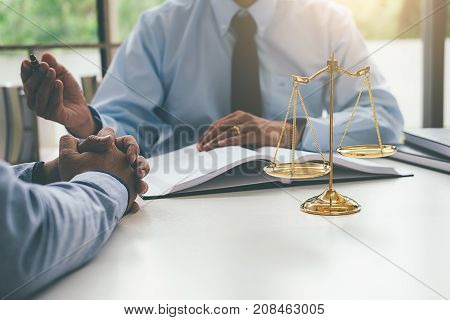 Judge Gavel With Justice Lawyers Having Team Meeting At Law Firm In Background. Concepts Of Law.