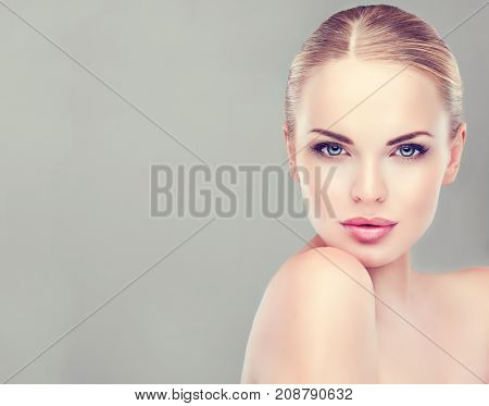 Beautiful Young Woman with Clean Fresh Skin look away  .Girl beauty face care. Facial  treatment   . Cosmetology , beauty  and spa . Beauty skin famale face stock photo