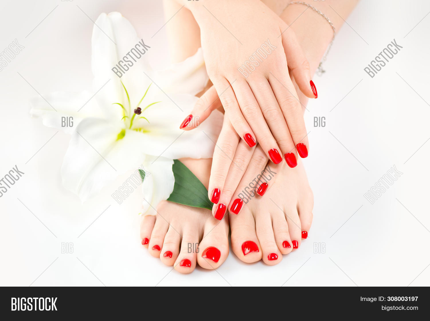 Manicure and Pedicure in beauty salon. Spa, skin care, moisturizing concept. Healthy Female hands an