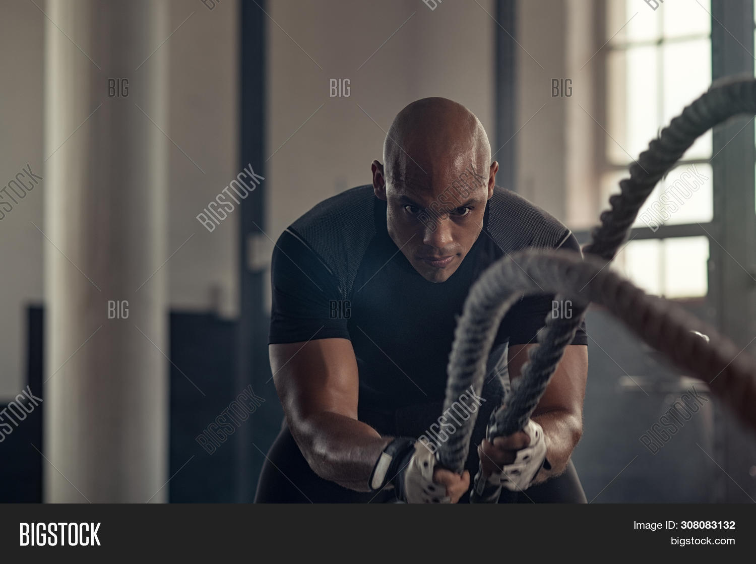 african,african american,african man,american,athlete,battle,battle rope,battle ropes,black,body,challenge,concentrated,copy space,dark,determination,determined,determined man,effort,endurance,exercise,fit,fitness,fitness training,functional,functional training,grunge,guy,gym,healthy,industrial,intensive,man,motivated,motivation,muscle,muscle man,people,rope,sport,sportsman,strength,strength training,sweat,trainer,training,waves,work out,workout,workout gym,young