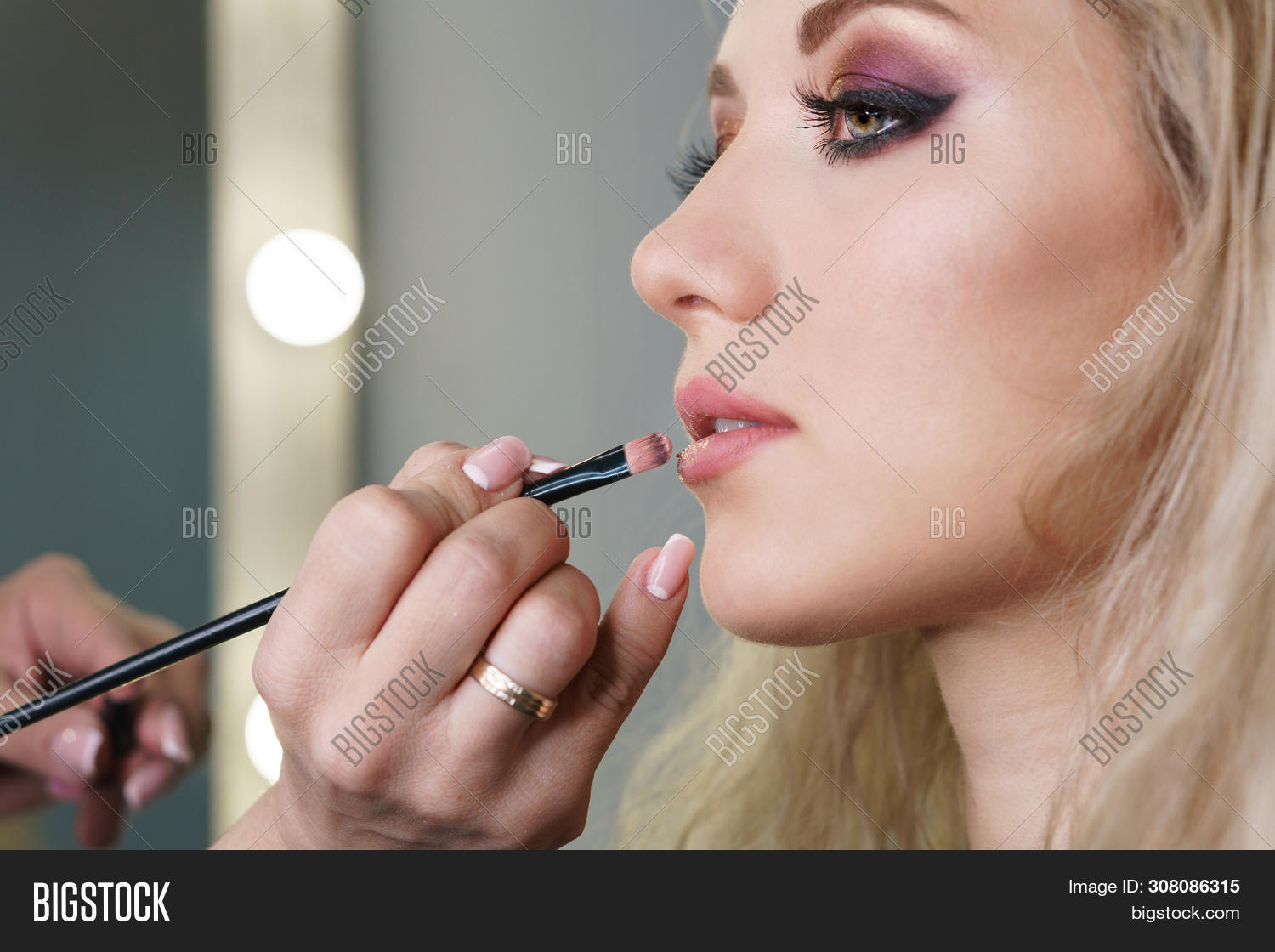 applying,artist,attractive,base,beautician,beautiful,beauty,brush,caucasian,client,cosmetic,cream,eyebrow,face,facial,fashion,female,feminine,girl,hair,hand,highlighter,indoors,lifestyle,make,make-up,makeup,model,mua,natural,occupation,people,portrait,preparation,pretty,product,professional,service,sexy,studio,style,styling,stylist,up,woman,work,young