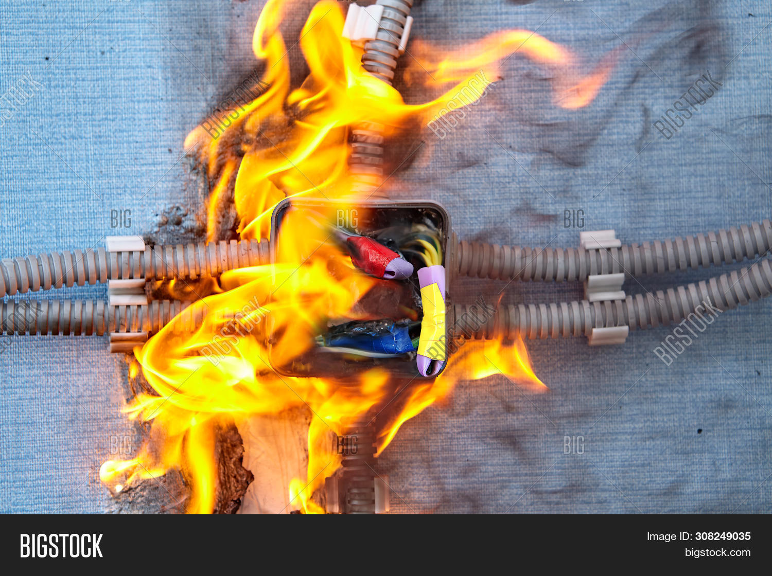 bad,box,broken,burn,burned,burning,burnout,burnt,cable,closeup,combustion,connection,damaged,danger,dangerous,defective,distribution,electric,electrical,electricity,equipment,failure,faulty,fire,flame,hazard,home,house,junction,nobody,overloaded,power,prevention,problem,process,protect,risk,safety,security,smoke,surge,system,voltage,wall,wire,wiring,wrong