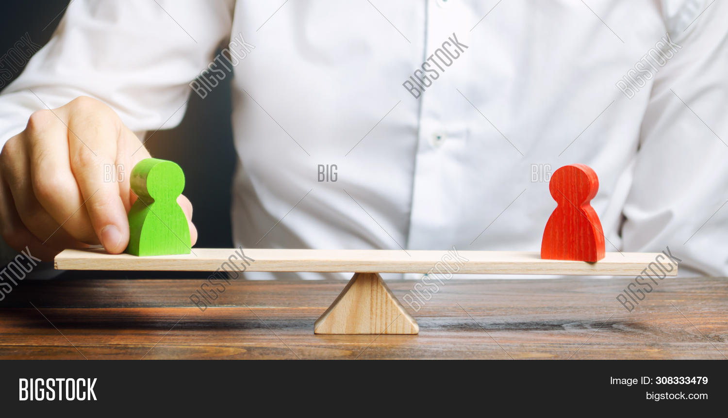 Wooden Figures Of People On Scales And A Mediator / Arbitrator. Resolving Conflict Situations And Di